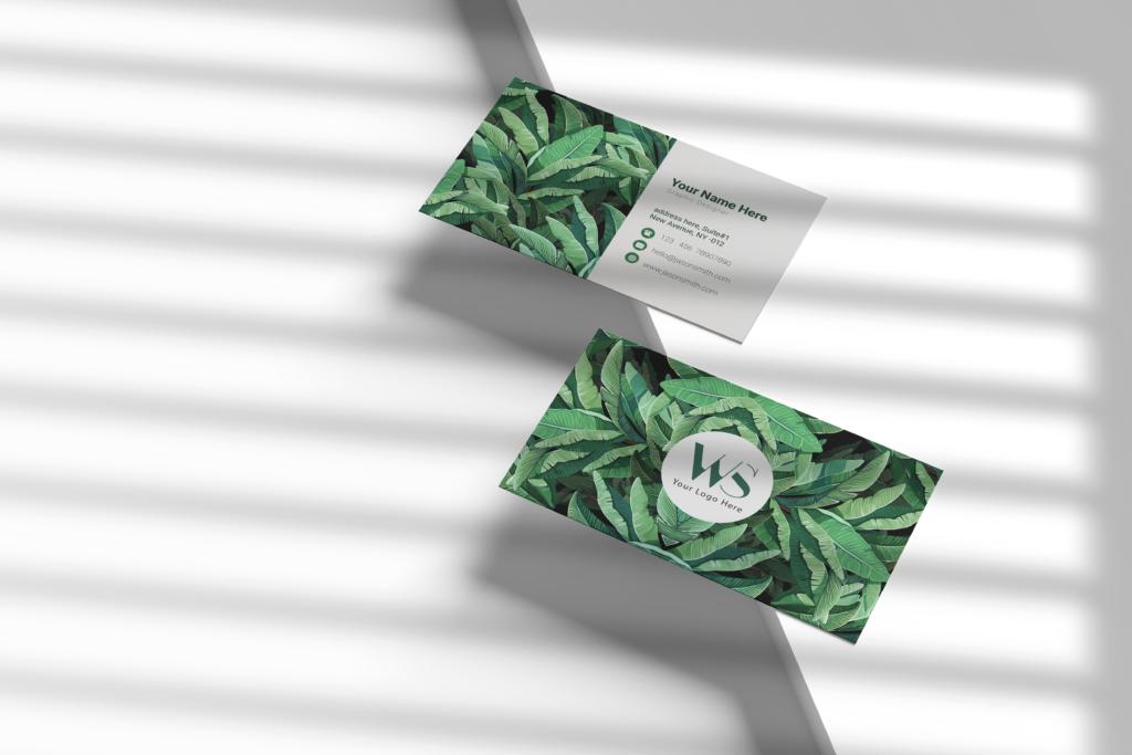 Tropical leaves background Visiting card design
